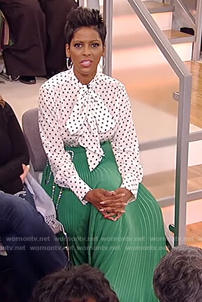 Tamron's white polka dot blouse and green pleated skirt on Tamron Hall Show