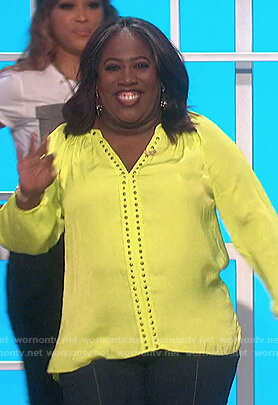 Sheryl's lime studded v-neck top on The Talk