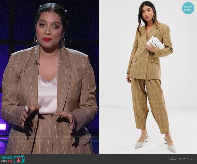 ASOS DESIGN camel stripe suit blazer with popper fastening and pants worn by Lilly Singh  on A Little Late with Lilly Singh