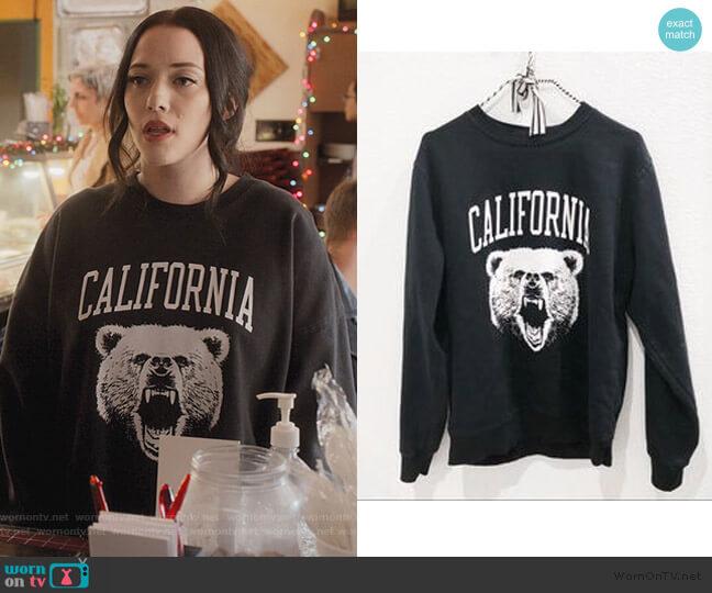 Erica Bear Sweatshirt by Brandy Melville worn by Jules Wiley (Kat Dennings) on Dollface