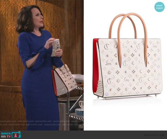 Megan Studded Paloma Tote by Christian Louboutin worn by Karen Walker (Megan Mullally) on Will & Grace