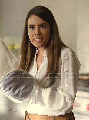 Cristal's white lace-trim blouse on Dynasty
