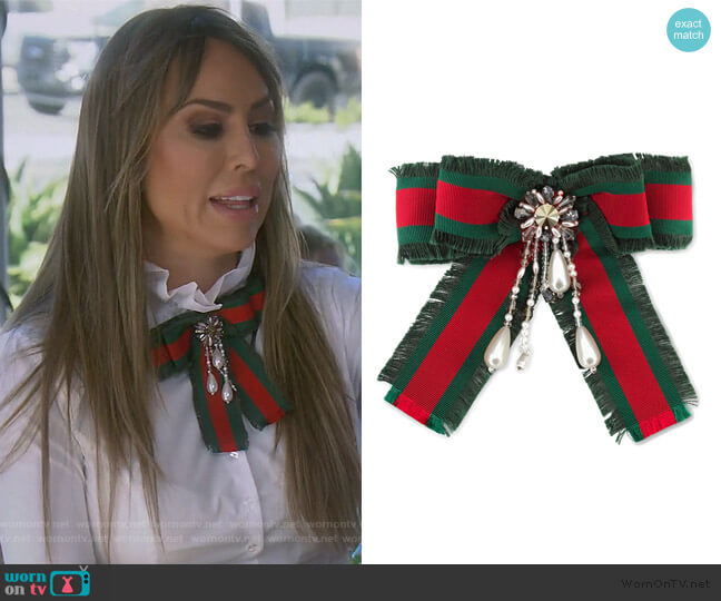 Web Bow brooch by Gucci worn by Kelly Dodd  on The Real Housewives of Orange County