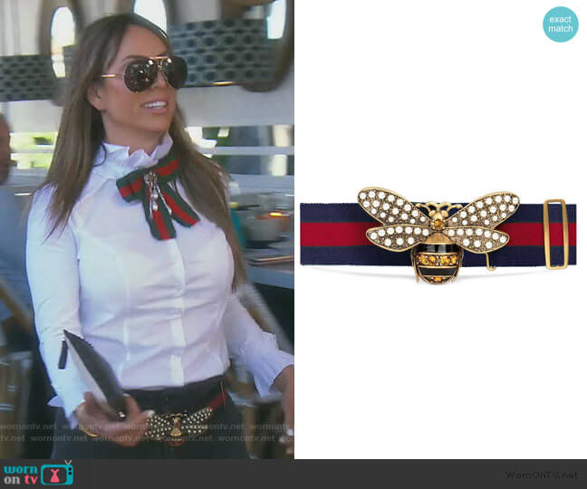 Web belt with bee by Gucci worn by Kelly Dodd  on The Real Housewives of Orange County