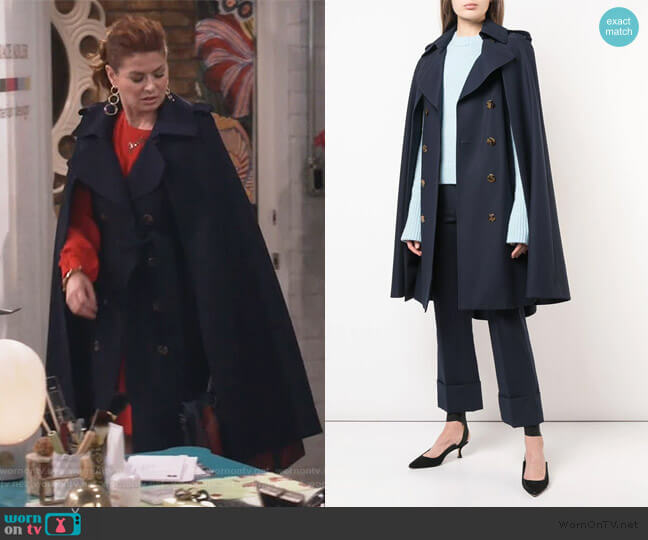 The Donna Trench Cape Coat by Khaite worn by Grace Adler (Debra Messing) on Will & Grace