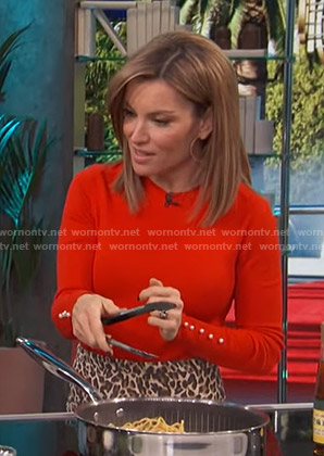 Kit's red sweater with pearl buttons on Access Hollywood