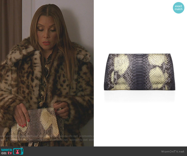 Python Slicer Clutch by Nancy Gonzalez worn by Dominique Deveraux (Michael Michele) on Dynasty