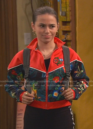 Tess's red floral print track jacket on Ravens Home