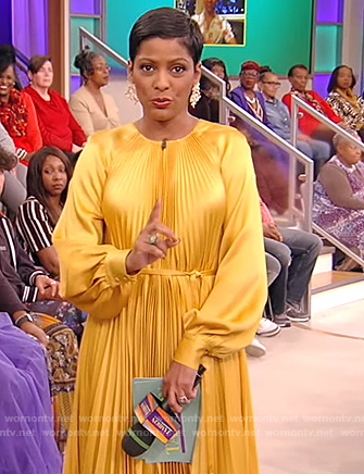 Tamron's yellow pleated dress on Tamron Hall Show