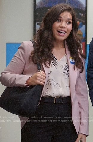 Amy's white printed blouse and pink blazer on Superstore