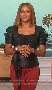 Eve's black leather wrap top on The Talk