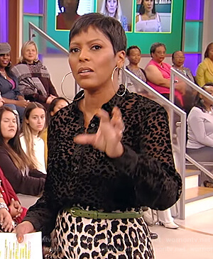 Tamron's black sheer leopard blouse and pants on Tamron Hall Show