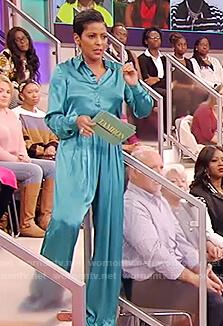 Tamron's teal satin blouse and pants on Tamron Hall Show