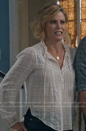 Claire's white pintuck top on Modern Family