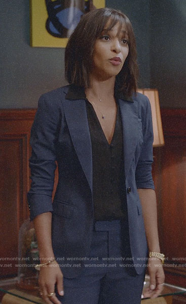 Edie's blue suit and black button front top on Almost Family