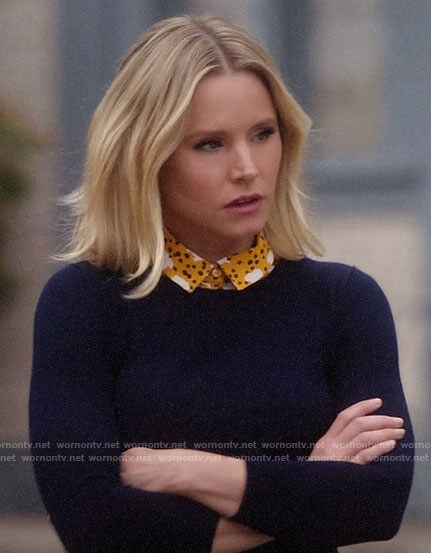 Eleanor's navy sweater and yellow sheep print shirt on The Good Place