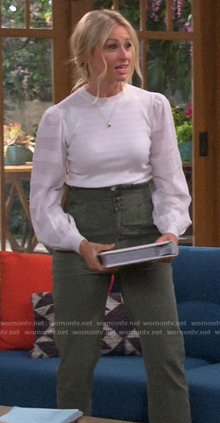 Gemma's white striped sleeve top and green high waisted pants on The Neighborhood