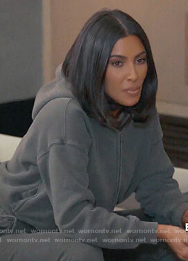 Kim's teal zip front hoodie on Keeping Up with the Kardashians