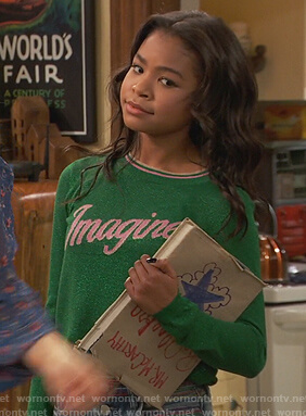 Nia's green imagine sweater on Ravens Home