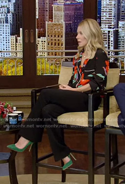 Kelly's black floral shirt and flare pants on Live with Kelly and Ryan