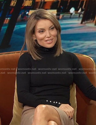 Kit's black turtleneck sweater with pearl buttons on Access Hollywood