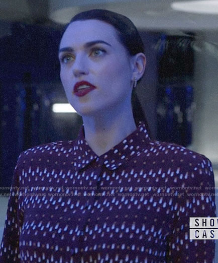 Lena's burgundy printed button down blouse on Supergirl