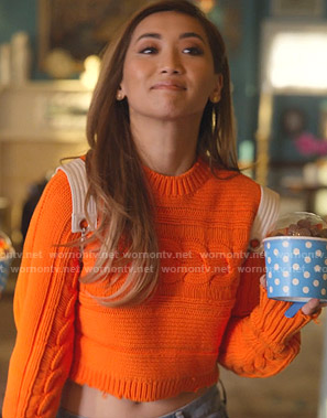 Madison's orange cropped sweater on Dollface