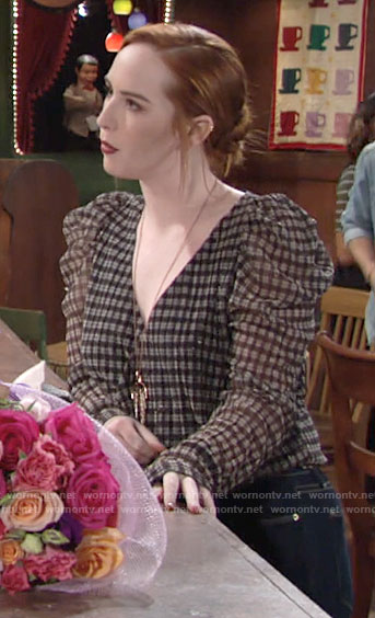 Mariah's plaid puff sleeve wrap top on The Young and the Restless