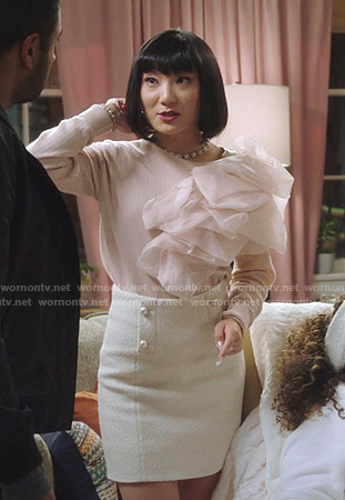 Mei's pink ruffled sweater and tweed mini skirt on Sunnyside