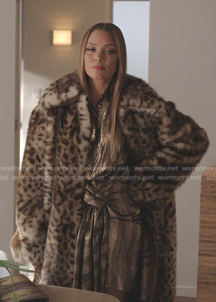 Dominique's striped dress and leopard print coat on Dynasty