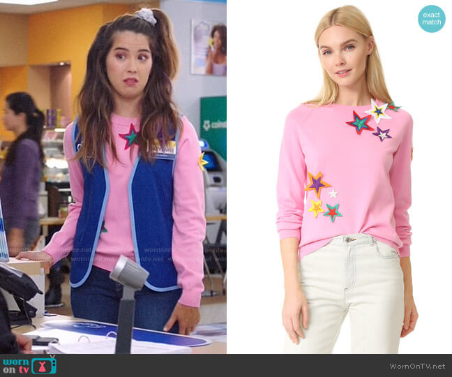 Mira Mikati Patched Star Sweater worn by Cheyenne (Nichole Bloom) on Superstore