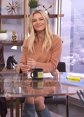 Morgan's orange sweater and knee high boots on E! News Daily Pop