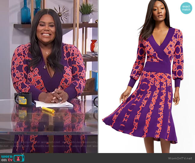 Link-Print Wrap Sweater and Pleated Sweater Skirt by New York & Company worn by Nina Parker  on E! News