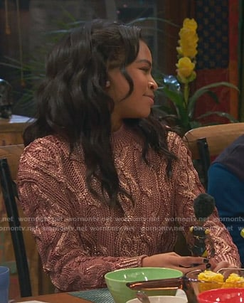 Nia's metallic cable knit sweater on Ravens Home