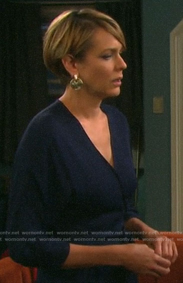 Nicole's navy open back jumpsuit on Days of our Lives