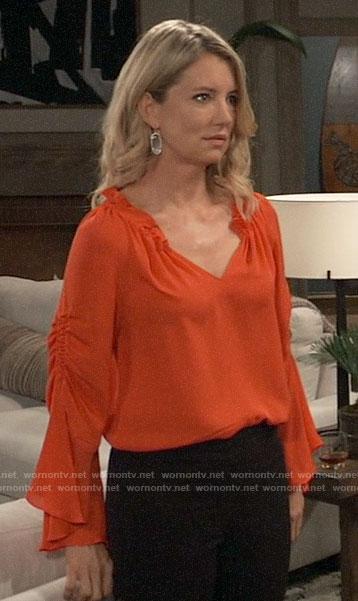 Nina's orange ruffle neck blouse on General Hospital