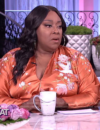 Loni's orange embroidered wrap dress on The Real
