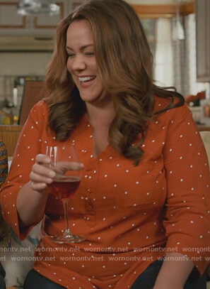 Katie's orange printed blouse on American Housewife