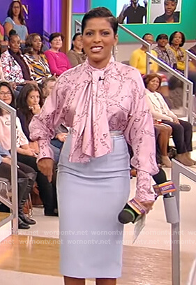 Tamron's pink chain print tie blouse on Tamron Hall Show