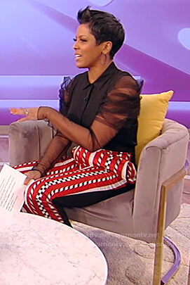 Tamron's black sheer sleeve blouse and pants on Tamron Hall Show