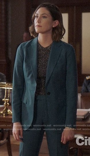 Sydney's teal suit and herringbone top on Bluff City Law
