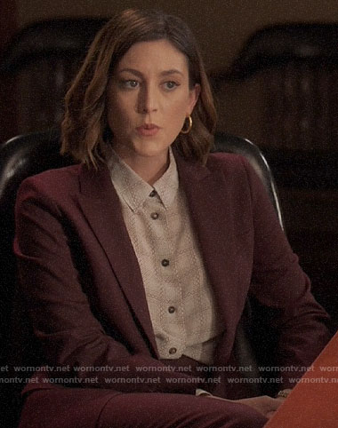 Sydney's printed blouse and burgundy suit on Bluff City Law