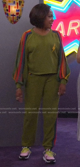 Tina's green sweatshirt with rainbow striped sleeves on The Neighborhood