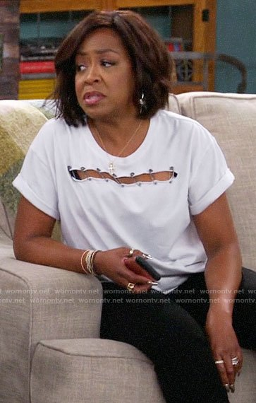 Tina's white safety pin detail tee on The Neighborhood