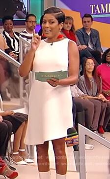 Tamron's white asymmetric dress on Tamron Hall Show