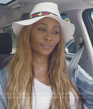 Cynthia's white bee embellished hat on The Real Housewives of Atlanta