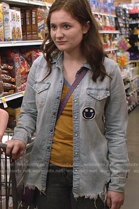 Debbie's blue distressed shirt with smiley patch on Shameless