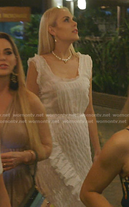 Kameron's white sleeveless midi dress with ruffles on The Real Housewives of Dallas
