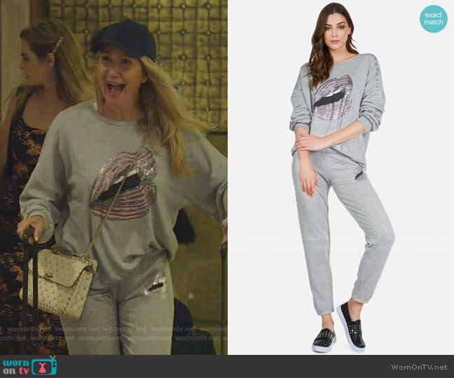 Sierra Chain Lip Sweatshirt and Brynn Sweatpant by Lauren Moshi  worn by Kary Brittingham  on The Real Housewives of Dallas