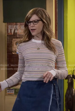 Lisa Loeb's striped sweater and raw-hem denim wrap skirt on Fuller House